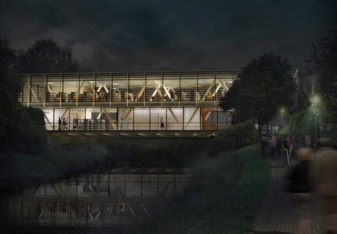 Mediathek spätabends vom Flussufer aus gesehen